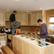 Two men working on kitchen.